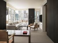 The Andaz 5th Avenue boasts spacious loft-style guestrooms with floor-to-ceiling windows.