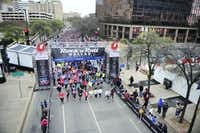Runners line up down Young St. as they begin the Dallas Rock N' Roll half-marathon on Sunday, March 23, 2014. (Matthew Busch/The Dallas Morning News)(Matthew Busch - Staff Photographer)
