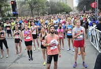 Runners listen as the national anthem is played before the start of the Dallas Rock N' Roll half-marathon on Sunday, March 23, 2014. (Matthew Busch/The Dallas Morning News)(Matthew Busch - Staff Photographer)