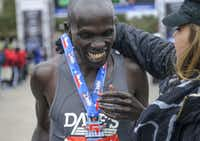 Men's overall winner Julius Kiptoo from Kenya smiles as he is awarded a Rock N' Roll medal after crossing the finish line of the Dallas Rock N' Roll half-marathon with a time of 1:06:02 on Sunday, March 23, 2014. (Matthew Busch/The Dallas Morning News)(Matthew Busch - Staff Photographer)