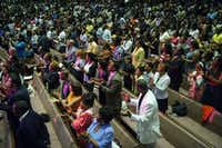 "The congregation at Oak Cliff Bible Fellowship sings in worship during at Oak Cliff Bible Fellowship's presentation of, ""The Greatest Doubt,"" on Easter Sunday, April 20, 2014. (Matthew Busch/The Dallas Morning News)(Matthew Busch - Staff Photographer)"