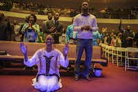 "Theresa Cain, bottom left, worships during the praise and worship portion of Oak Cliff Bible Fellowship's presentation of, ""The Greatest Doubt,"" on Easter Sunday, April 20, 2014. (Matthew Busch/The Dallas Morning News)Matthew Busch - Staff Photographer"