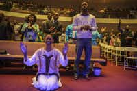 "Theresa Cain, bottom left, worships during the praise and worship portion of Oak Cliff Bible Fellowship's presentation of, ""The Greatest Doubt,"" on Easter Sunday, April 20, 2014. (Matthew Busch/The Dallas Morning News)(Matthew Busch - Staff Photographer)"