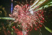 Fireworks double-exposed over a backdrop of the crowd celebrating Independence Day in the Cotton Bowl at Fair Park on Friday night.Brittany Sowacke - Staff Photographer