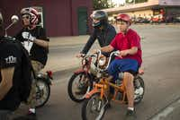 Jack Graham, right, of Dallas, Texas is the youngest member of the Pine Box Pedal Club. He often buys non-running mopeds from Kyle's Scooter Shops and learns how to fix them on his own.( Brittany Sowacke  -  Staff Photographer )