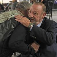 Reggie Gutierrez (left), hugs Gil Benoit during the VFW Post 4380 casino night fundraiser. Benoit won the Congressional Veteran Commendation award.( Staff photo by Kirsten Kearse  - Staff photographer)