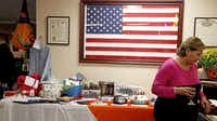 Julie Urias, president of the Ladies' Auxiliary, looks at the donations given for the silent auction at the VFW Post 4380 casino night that benefited the auxiliary.(Kirsten Kearse - Staff photographer)