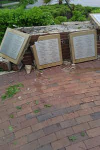 The garden wall, where names in memory are listed, was demolished in an accident on April 17, 2010. The same wreck broke a tree and destroyed the electrical box.