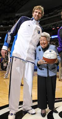"""As part of her 99th-birthday celebration, Ebby received a team-signed ball from Dirk Nowitzki before a Mavericks game. """"I tell you, I looked up and could barely see his face,"""" said the under-5-foot Ebby.(2010 File Photo - Staff)"""