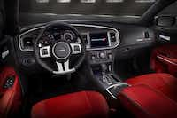 Inside the 2013 Dodge Charger SRT8,  black-faced gauges and a leather-covered steering wheel give it some edge,.