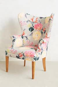 Pocketful of posies: The Lotus Blossom wingback chair from Anthropologie ($1,398) warms up a modern interior without going granny. anthropologie.com.( Anthropologie  - THE WASHINGTON POST)