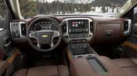 The Chevy High Country's interior features heated and cooled perforated premium leather front bucket seats, an 8-inch touch screen, and front and rear park assist.GM