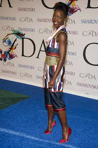 Lupita Nyong'o attends the CFDA Fashion Awards on Monday, June 2, 2014 in New York. (Photo by Charles Sykes/Invision/AP)Charles Sykes - Charles Sykes/Invision/AP