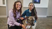 Take two. Much better. Courtney Shlensky and Noura Jammal of the Richardson Animal Shelter show off Rufus.