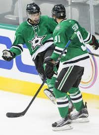 Stars left wing Patrick Sharp celebrates with Tyler Seguin after scoring during the second period against Tampa Bay on Saturday, Sept. 26, 2015. (Smiley N. Pool/The Dallas Morning News)