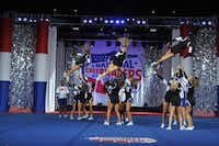 Cheer team members engage in a choreographed mid-air spin as their teammates prepare to catch them during a performance at National Cheerleaders Association's championship competition.Photo submitted by DANIELLE WEBER