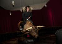 Sally Glass rides the mechanical bull installed temporarily inside the Nasher Sculpture Center.( Special Contributor  -  Nan Coulter  )