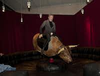 Nancy Whitenack rides the mechanical bull installed temporarily inside the Nasher Sculpture Center.( Special Contributor  -  Nan Coulter  )