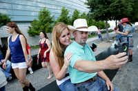 George Strait fans Kourtney Rae Dickerson of Stephenville, Texas, and Dusty Trimuar of Beeville, Texas, take a photo before the last show of his final tour at AT&T Stadium in Arlington.Andy Jacobsohn  -  Staff Photographer