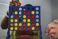 A boy drops a chip in a game of Connect Four at the Henry Wade Juvenile Justice Center in Dallas on Feb. 10, 2015.( Rose Baca  -  Staff Photographer )