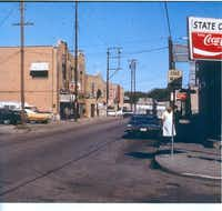 Shops line Thomas Street in the predominately African-American State Thomas neighborhood in the early 1960s.Photo submitted by ROBERT PRINCE