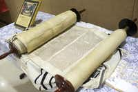 One of the Torahs the Nazis intended to display in a museum about the extinct Jewish people was unrolled at Congregation Beth Torah. The 25th anniversary of the synagogue's obtaining the scroll was marked Sunday.Matthew Busch - Staff Photographer