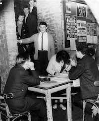 Aug. 3, 2013 marked 50 years since the Beatles performed their last show at the famous Cavern Club in Liberpool.  The Beatles played there almost 300 times in their early career. This photo, from April 1963, shows visitors to the Cavern Club filing down the steep stairs to be let in by a bouncer. They were then required to sign in before gaining entrance. Note the Beatles poster on the wall.