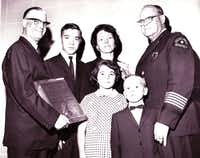 Maria Tippit and her children -- Allan, Brenda and Curtis -- attended a ceremony in which Officer J.D. Tippit was proclaimed a hero in 1964. The plaque presentation was made by  E.C. McFadden and Dallas police Chief Jesse Curry.