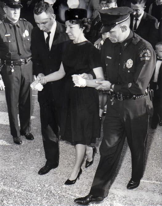 Marie Tippit was escorted by a mourner and a police officer at the funeral of her husband on Nov. 25, 1963. J.D. Tippit was buried at Laurel Land Memorial Park.