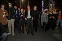 Nasher Sculpture Center director Jeremy Strick (center) and Nancy Nasher (left of center) join patrons to watch the closing fireworks for Chalet Dallas.( Special Contributor  -  Nan Coulter  )