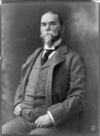 John Hay, three-quarter length portrait, seated, facing left, circa 1902.