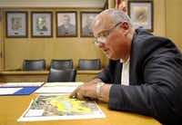 """Fannin County Judge Creta """"Spanky"""" L. Carter Jr. pointed to where he thinks residential and commercial zoning will be near the new reservoir dam.( Tom Fox  -  Staff Photographer )"""