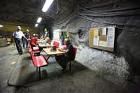 Employees break for lunch  deep underground at the Morton Salt Mine. Most equipment is brought down in pieces on the elevator and reassembled, including front-loaders and trucks. The 57-story ride takes several minutes.(Photos by Louis DeLuca - Staff Photographer)