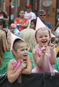 Children got a thrill out of riding in the parade in downtown Ennis at the festival.( Louis DeLuca  -  Staff Photographer )