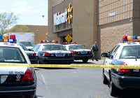LAS VEGAS, NV - JUNE 08:  A Las Vegas Metropolitan Police Department officer walks outside a Wal-Mart on June 8, 2014 in Las Vegas, Nevada. Two officers were reported shot and killed by two assailants at a pizza restaurant near the Wal-mart. The two suspects then reportedly went into the Wal-Mart where they killed a third person before killing themselves.  (Photo by Ethan Miller/Getty Images)Ethan Miller - Getty Images