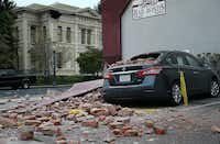 NAPA, CA - AUGUST 24:  Bricks from a damaged building sit on a car following a reported 6.0 earthquake on August 24, 2014 in Napa, California.  A 6.0 earthquake rocked the San Francisco Bay Area shortly after 3:00 am on Sunday morning causing damage to buildings and sending at least 70 people to a hospital with non-life threatening injuries.(Justin Sullivan - Getty Images)
