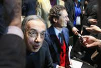 DETROIT, MI - JANUARY 13:  Sergio Marchionne (L), Chairman and CEO of Chrysler Group LLC, and John Elkann, chairman of Fiat, field questions following Chrysler's introduction of the 2015 Chrysler 200 at the North American International Auto Show (NAIAS) on January 13, 2014 in Detroit, Michigan. The auto show opens to the public January 18-26.  (Photo by Scott Olson/Getty Images)(Scott Olson - Getty Images)