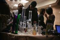 WASHINGTON, DC - FEBRUARY 28:  Attendees check out smoking pipes during a ComfyTree Cannabis Academy conference February 28, 2015 in Washington, DC. Attendees participated in the conference to gain knowledge on how to legally enter and operate in the cannabis industry.  (Photo by Alex Wong/Getty Images)(Alex Wong - Getty Images)