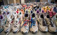 Running shoes are laid out en masse at the Boston Public Library display. The surviving suspect, Dzhokhar Tsarnaev, is set to go to trial in November.Andrew Burton - Getty Images