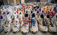 Running shoes are laid out en masse at the Boston Public Library display. The surviving suspect, Dzhokhar Tsarnaev, is set to go to trial in November.(Andrew Burton - Getty Images)
