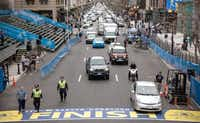 Police patrolled the finish line Monday for next week's race. Last year, two pressure-cooker bombs killed three people and injured an estimated 264 others there.( Andrew Burton  -  Getty Images )