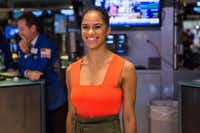 Ballet star Misty Copeland poses for photos on the floor of the New York Stock Exchange before ringing the closing bell on Monday. Copeland is the principal dancer for the American Ballet Theatre and the model for the joint project announced Wednesday by Dallas Black Dance Theatre and the American Ballet Theatre. (Photo by Andrew Burton/Getty Images)