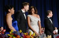 WASHINGTON, DC - MAY 3:  First lady Michelle Obama and Comedian Joel Mchale share a laugh on stage at the annual White House Correspondent's Association Gala at the Washington Hilton hotel May 3, 2014 in Washington, D.C. The dinner is an annual event attended by journalists, politicians and celebrities. (Photo by Olivier Douliery-Pool/Getty Images)(Pool - Getty Images)
