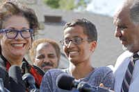 Attorney Linda Moreno discussed the case with Ahmed Mohamed and his father, Mohamed Elhassan Mohamed, outside the family's home on Wednesday.( Ben Torres  -  Getty Images )