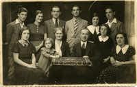 The Sternberg family in 1935 or 1936 during Passover in Munkács, the last time the entire immediate family was all together. Top row, from left: Wilmos, Lily, Marcel, Moric, Claire, Eugene. Bottom row, from left: Aranka, Magda, Franceska, Julius, Hansi, Shari. Names in bold are the four sisters who survived the Holocaust together. Aranka, Julius, Franceska, Shari and Shari's young daughter, Fritzi, were all killed at Auschwitz.( Naomi Martin )