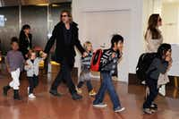 Stars on the move: Brad Pitt and Angelina Jolie escort their kids through Haneda Airport in Tokyo last November.