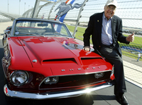 Carroll Shelby struck a  happy pose with a 1968 GT500-KR during the celebration of the 40th Anniversary of the Ford Mustang at the Nashville Super Speedway in Lebanon, Tenn.