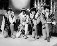 The Beatles pose during a rehearsal of William Shakespeare's A Midsummer night's dream on April 29, 1964, in London.