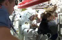 This July 16, 2013 NASA TV image shows International Space Station Italian astronaut Luca Parmitano being assisted back into the safety of the station by his fellow astronauts after experiencing problems with his spacesuit. Parmitano had a leak in his helmet while on a spacewalk outside the International Space Station Tuesday, forcing an early end to the outing, NASA said. NASA is probing whether the leak may have come from the liquid cooling ventilation system in the spacesuit, which contains about a gallon of water treated with iodine and may have a bad taste like Parmitano described.HO/AFP/Getty Images - AFP PHOTO / NASA TV / NO SALES / NO MARKETING / NO ADVERTISING CAMPAIGNS / DISTRIBUTED AS A SERVICE TO CLIENTS