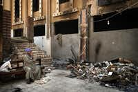 An Egyptian Coptic Christian sits on a bench near debris that remains in the courtyard of Amba Moussa Coptic Church after it was vandalized and torched by unknown assailants this month in the central Egyptian city of Minya. Egypt's Christians are living in fear after a string of attacks against churches, schools and shops, said to be targeted by supporters of deposed Islamist president Mohamed Morsi.